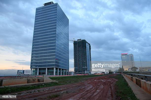 The towers of the World Trade Centre stand during construction in Abuja Nigeria on Wednesday Oct 21 2015 A drop in crude prices in the past year has...