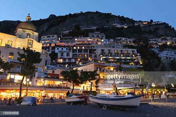 The town center stands illuminated at dusk on July 27 2011 in Positano Italy The Amalfi coastline is among Italy's most popular tourist destinations