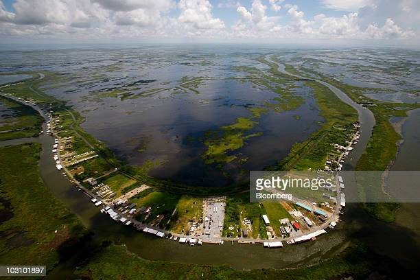 The town of Delacroix Louisiana US is pictured from the air on July 26 2010 BP Plc returned to work on permanently plugging the source of the largest...