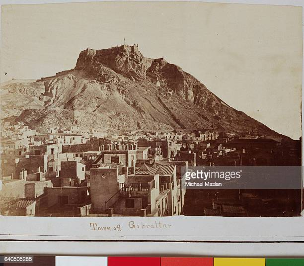 The town of Gibraltar a British Crown Colony in southern Spain The town lies at the base of a high limestone hill the Rock of Gibraltar There is a...