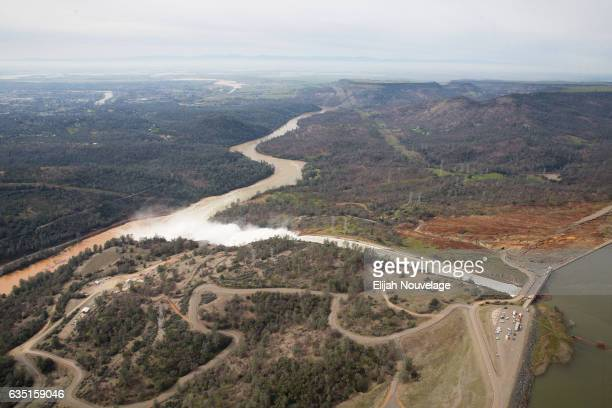The town of Oroville is seen downstream from the Oroville Dam from the air on February 13 2017 in Oroville California Almost 200000 people were...