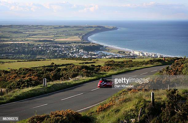 The town of Ramsey catches the evening light in the distance as a competitor rides during a practice session on June 5 2009 on the Isle Of Man United...