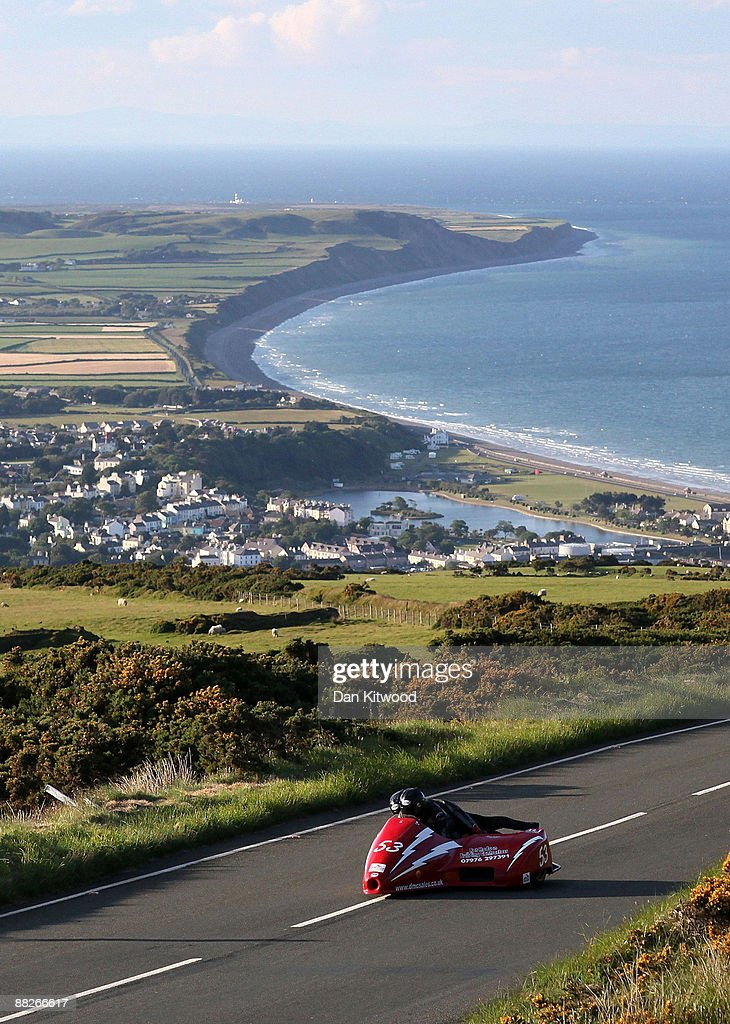 The town of Ramsey catches the evening light in the distance as a competitor rides during a practice session on June 5, 2009 on the Isle Of Man, United Kingdom. Adverse weather conditions prevented the much anticipated Superbike race from taking place on Saturday and, depending on the rain, may be off all weekend. The annual TT race is one of the highlights of the motorbike racing calender with fans travelling from around the globe to watch riders compete in the 37 and three quarter mile lap exceeding speeds of 200mph.