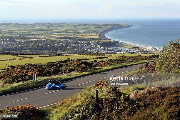 The town of Ramsey catches the evening light in the distance as a competitor rides during a practice session on June 5 Isle Of Man United Kingdom...
