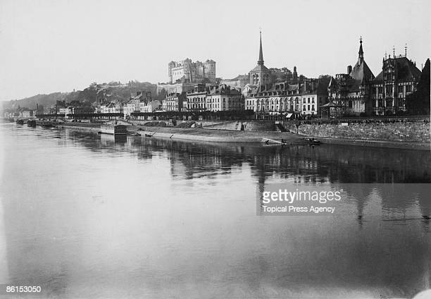 The town of Saumur MaineetLoire on the banks of the Loire river France 1909