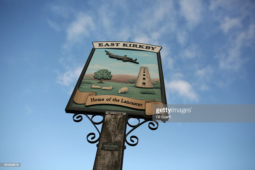 The town sign for East Kirkby, where the Lincolnshire Aviation Heritage Centre is located and the Lancaster bomber 'Just Jane', which is being restored with the aim of getting it airworthy, on February 14, 2013 in East Kirkby, England. The plane, which last flew in 1971, would become one of only three airworthy Lancaster bombers in the world. Brothers Fred and Harold Panton, owners of the Lincolnshire Aviation Heritage Centre, are restoring the plane in memory of their sibling, Christopher Panton, who died aged 19 when his Lancaster was shot down in 1944.