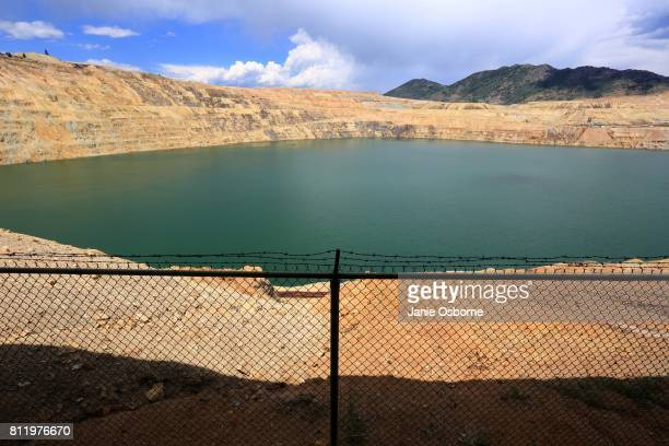 The toxic Berkeley Pit is seen from the Visitor Information and Viewing Stand on July 6 2017 in Butte Montana Formerly an open pit copper mine today...
