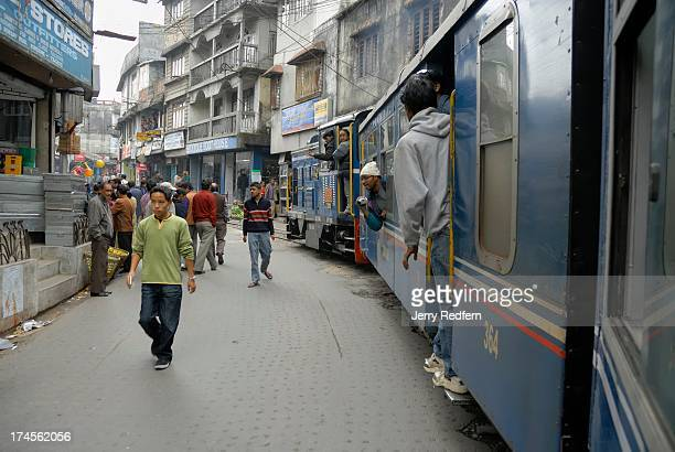 The Toy Train slowly makes its way through the narrow streets it shares with car and foot traffic in Kalimpong as it rises through the Himalayan...