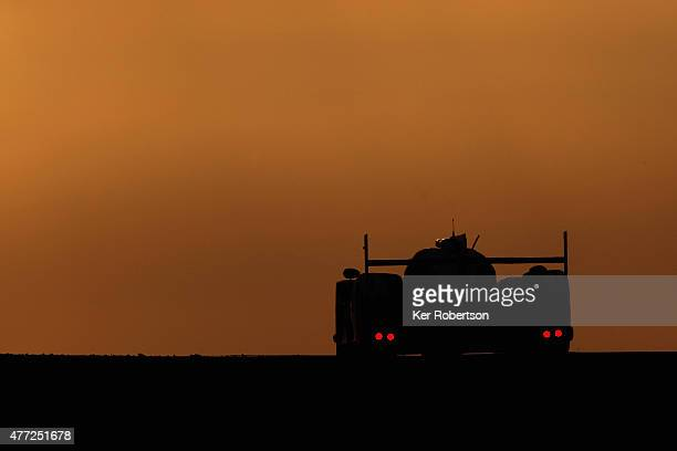 The Toyota TS 040 Hybrid of Anthony Davidson Sebastien Buemi and Kazuki Nakajima drives under the Dunlop Bridge at dawn during the Le Mans 24 Hour...