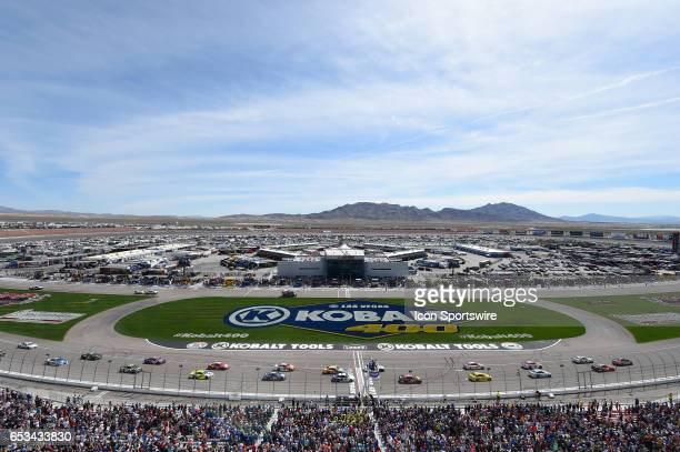 The Toyota Camry pace car leads the field past the start/finish line for one pace lap to go before the start of the race during the Kobalt 400 NASCAR...