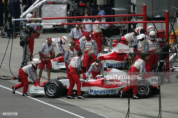 The Toyota F1 team withdraw their cars after the start of the United States F1 Grand Prix at the Indianapolis Motor Speedway on June 19 2005 in...