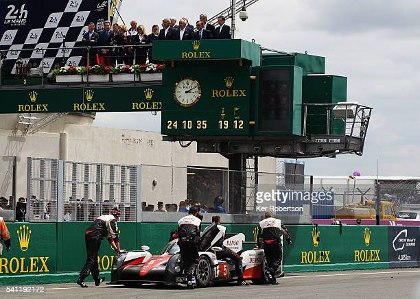 The Toyota Gazoo Racing is pushed back to parc ferme after suffering engine problems at the end of the Le Mans 24 Hour race handing victory to the...