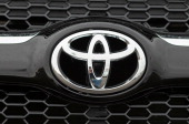 The Toyota logo is displayed on the front of a brand new RAV4 at a Toyota dealership on February 24 2011 in Oakland California Toyota announced today...