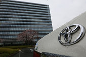 The Toyota Motor Corp badge is displayed on the real of a vehicle outside the company's headquarters in Toyota City Aichi Prefecture Japan on Sunday...