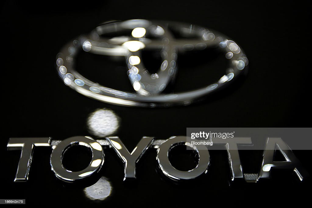 The Toyota Motor Corp. logo is displayed on a FJ Cruiser sport-utility vehicle (SUV) at the company's showroom in Tokyo, Japan, on Tuesday, Nov. 5, 2013. Toyota, the world's largest automaker, will probably deliver record semiannual profit when it reports earnings tomorrow, as the weaker yen bolsters the value of Japanese cars sold overseas. Photographer: Kiyoshi Ota/Bloomberg via Getty Images