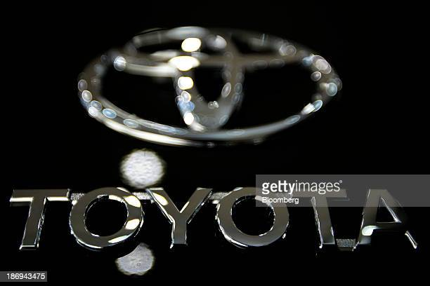 The Toyota Motor Corp logo is displayed on a FJ Cruiser sportutility vehicle at the company's showroom in Tokyo Japan on Tuesday Nov 5 2013 Toyota...