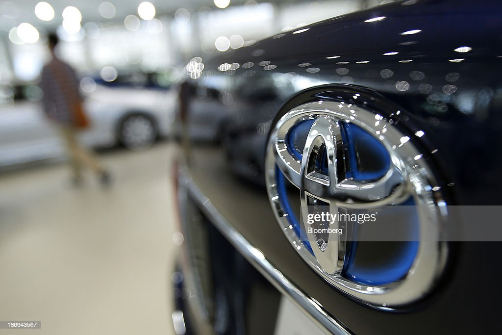 The Toyota Motor Corp. logo is displayed on the back of a Crown Royal sedan at the company's showroom in Tokyo, Japan, on Tuesday, Nov. 5, 2013. Toyota, the world's largest automaker, will probably deliver record semiannual profit when it reports earnings tomorrow, as the weaker yen bolsters the value of Japanese cars sold overseas. Photographer: Kiyoshi Ota/Bloomberg via Getty Images
