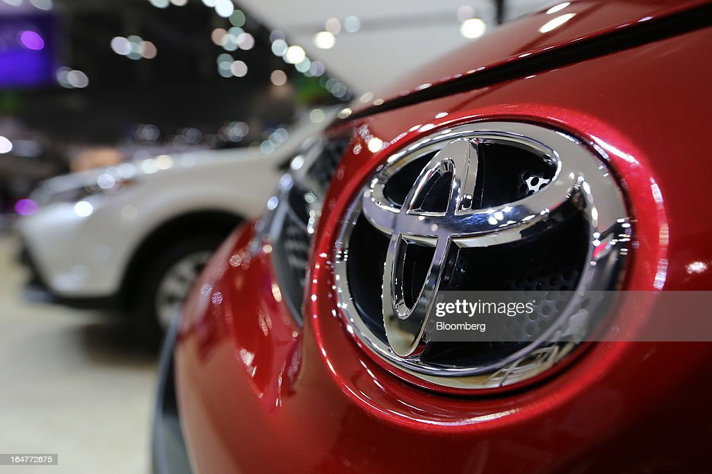 The Toyota Motor Corp. logo is displayed on the company's RAV4 crossover vehicle during the press day of the Seoul Motor Show in Goyang, South Korea, on Thursday, March 28, 2013. The show runs from today until April 7. Photographer: SeongJoon Cho/Bloomberg via Getty Images