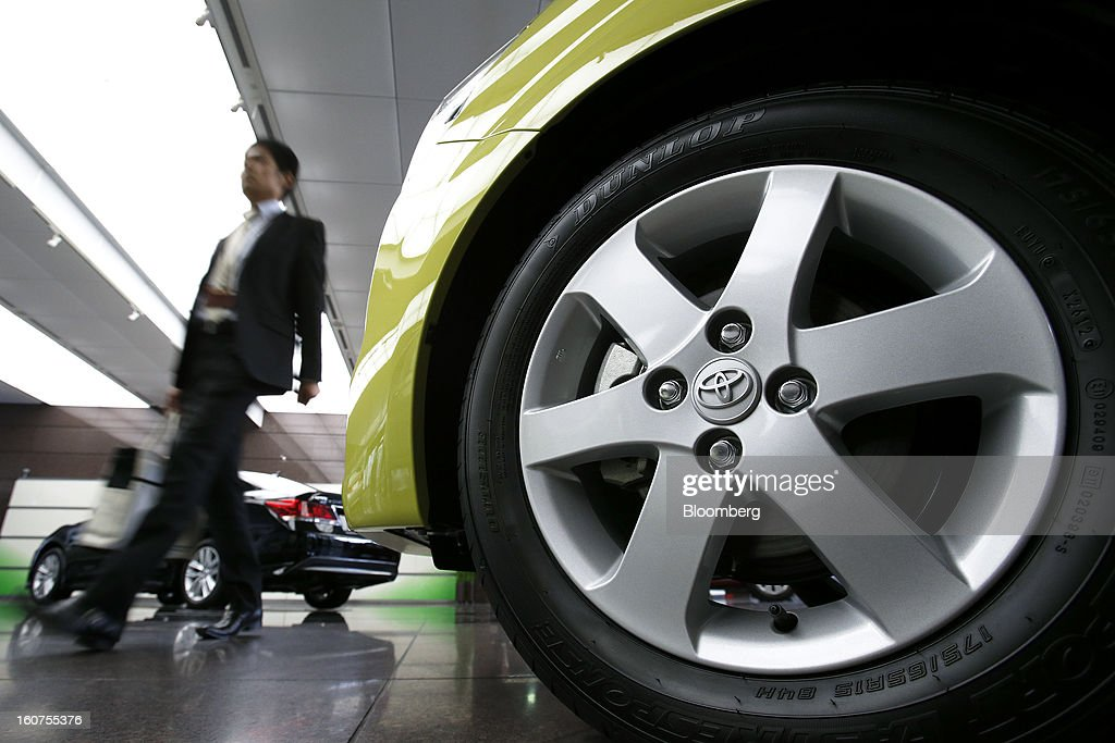 The Toyota Motor Corp. logo is displayed on the wheel cap of a vehicle displayed at the company's headquarters in Tokyo, Japan, on Tuesday, Feb. 5, 2013. Toyota, the world's biggest carmaker, raised its profit forecast after the yen weakened more than any other currency, raising the value of Japanese cars sold overseas. Photographer: Kiyoshi Ota/Bloomberg via Getty Images
