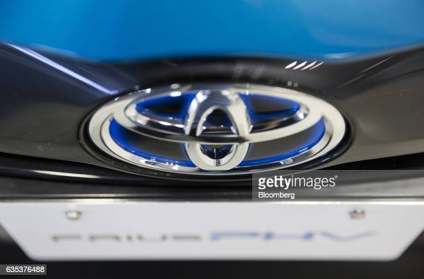 The Toyota Motor Corp logo is seen on a Prius plugin hybrid vehicle known as Prius Prime in the US during a test drive ahead of its sales launch...