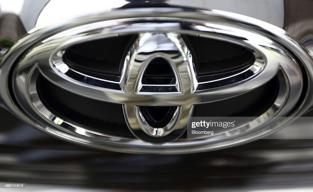 The Toyota Motor Corp. logo sits on a vehicle at the company's head office in Tokyo, Japan, on Thursday, May 8, 2014. Toyota, the world's largest carmaker, forecast profit will fall from last year's record as demand slumps in Japan, competition intensifies in the U.S. and the yen is no longer the boon it used to be. Photographer: Tomohiro Ohsumi/Bloomberg via Getty Images