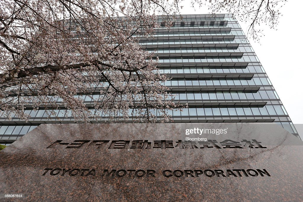The Toyota Motor Corp signage is seen in front of the company's headquarters stands in Toyota City Aichi Prefecture Japan on Sunday March 29 2015...