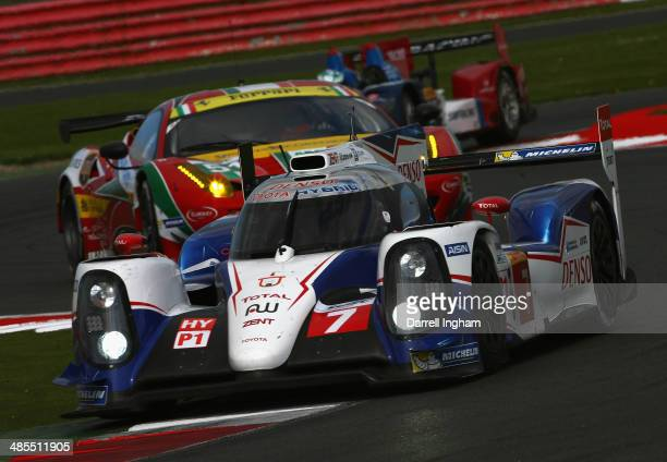 The Toyota Racing Toyota TS040 Hybrid LMP1 driven by Kazuki Nakajima of Japan Stephane Sarrazin of France and Alexander Wurz of Austria during...