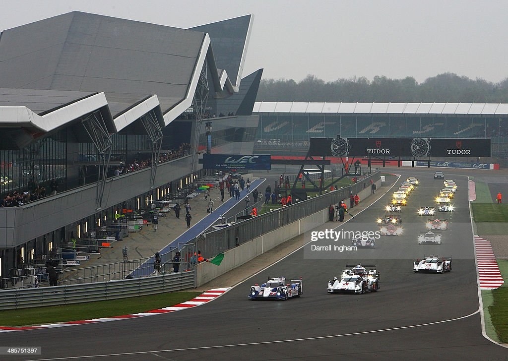 The #7 Toyota Racing Toyota TS040 Hybrid LMP1 driven by Kazuki Nakajima of Japan, Stephane Sarrazin of France and Alexander Wurz of Austria leads the field at the start of the FIA World Endurance Championship 6 Hours of Silverstone sportscar race at the Silverstone Circuit on April 20, 2014 in Northampton, England.
