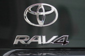 The Toyota RAV4 logo is displayed on the back of a brand new RAV4 at a Toyota dealership on February 24 2011 in Oakland California Toyota announced...