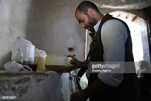 The tradition of Yemenis 'oil trade' continues with sesame oil produced in sesame mills in Sanaa Yemen on 1 May 2014 Sesame oil is regarded as...