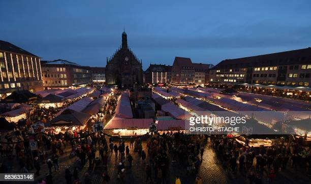 The traditional Christmas Market opens in front of the Frauenkirche in Nuremberg southern Germany on December 1 2017 The traditional 'Nuernberger...