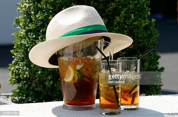 The traditional English summer drink of Pimms and a convenient place to leave a AELTC hat during Day 8 of the 2009 Wimbledon Tennis Championships at...