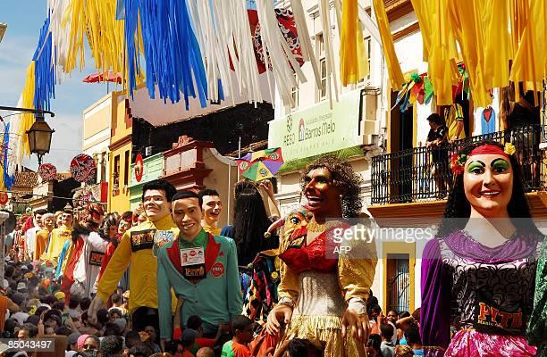 The traditional Giant Dolls of Olinda parade among thousand of revelers during carnival on February 24 in Olinda Pernambuco northern Brazil AFP PHOTO...