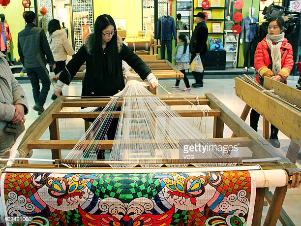 The traditional handmade crossstitch embroidery techinque for brocade shows at Nanjing Yunjin Museum on January 27 2015 in Nanjing Jiangsu province...