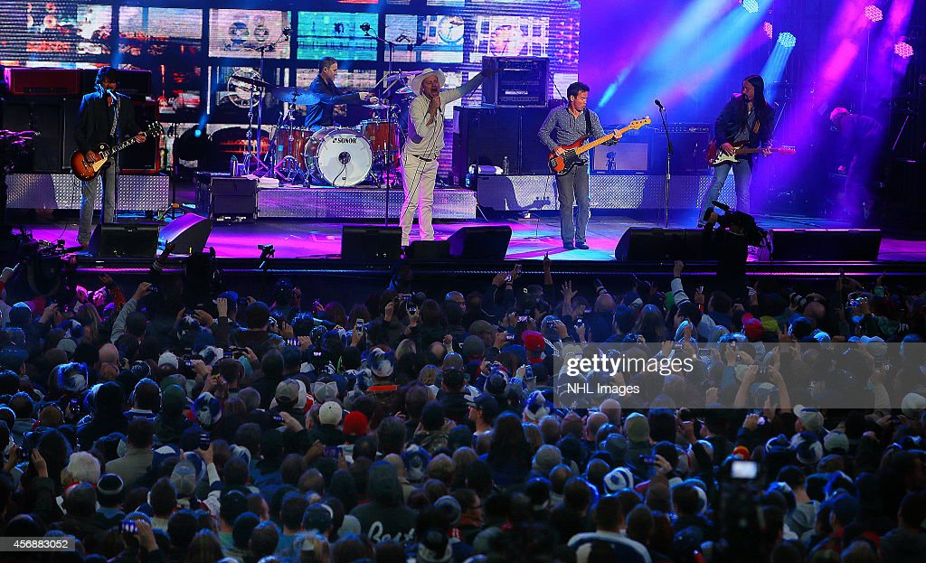 The Tragically Hip performs during Molson Canadian NHL FaceOff 2014 at YongeDundas Sq October 8 2014 in Toronto Ontario Canada