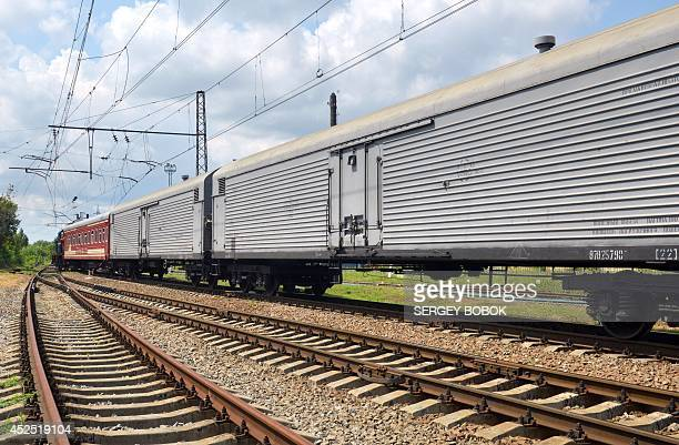The train carrying the 280 bodies recovered from the downed Malaysian flight MH17 arrives at the Malyshev Tank Plant in the governmentheld Ukrainian...
