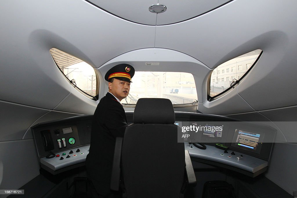 The train driver of the high speed train that runs on the new 2,298-kilometre (1,425-mile) line between Beijing and Guangzhou takes a rest in Zhengzhou train station in Zhengzhou, central China's Henan province on December 26, 2012. China started service on December 26 on the world's longest high-speed rail route, the latest milestone in the country's rapid and -- sometimes troubled -- super fast rail network. The opening of this new line means passengers will be whisked from the capital to the southern commercial hub in just eight hours, compared with the 22 hours previously required. CHINA