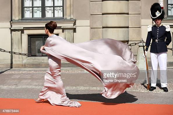 The train of a guest's dress blows in the wind arriving to the royal wedding of Prince Carl Philip of Sweden and Sofia Hellqvist at The Royal Palace...