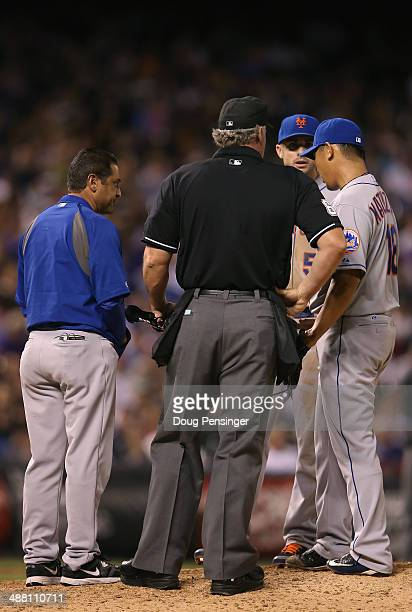 The trainer visits the mound to check on Daisuke Matsuzaka of the New York Mets as he works against the Colorado Rockies at Coors Field on May 3 2014...