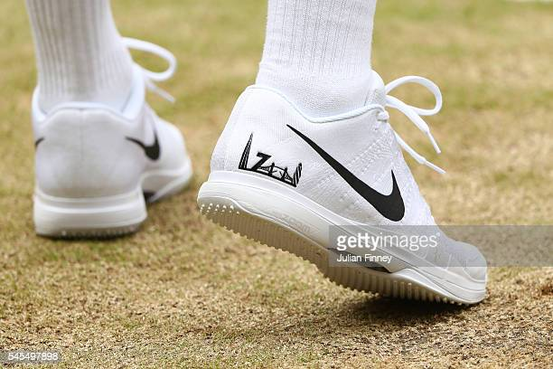 The trainers of Roger Federer of Switzerland are seen during the Men's Singles Semi Final match against Milos Raonic of Canada on day eleven of the...