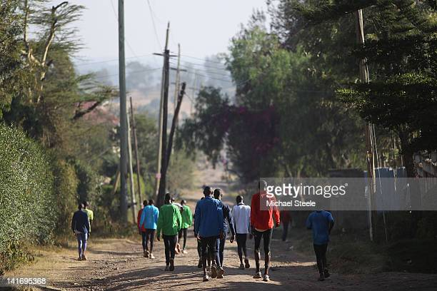 The training group of Patrick Makau of Kenya holder of the world marathon record walk back to their training base after an early morning run on...