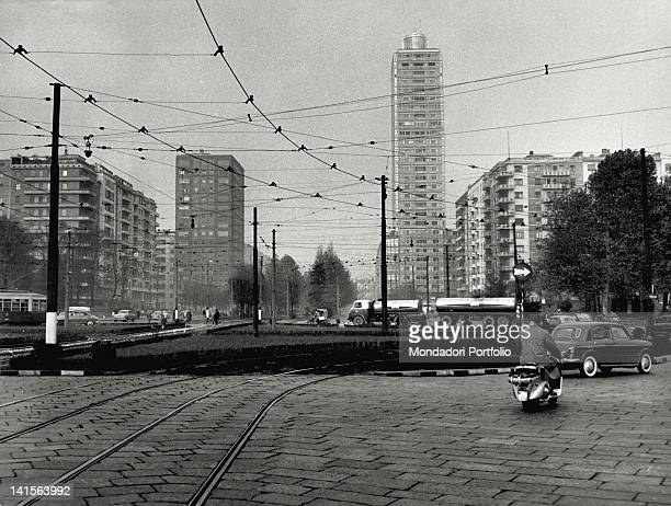 The tram line in piazza della Repubblica in Milan The traffic and a skyscraper in the background Milan the '60s