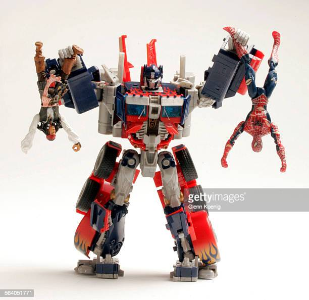 The Transformer Optimus Prime holds Capt Jack Sparrow and Spider–Man This photo is for a story about movie toy products