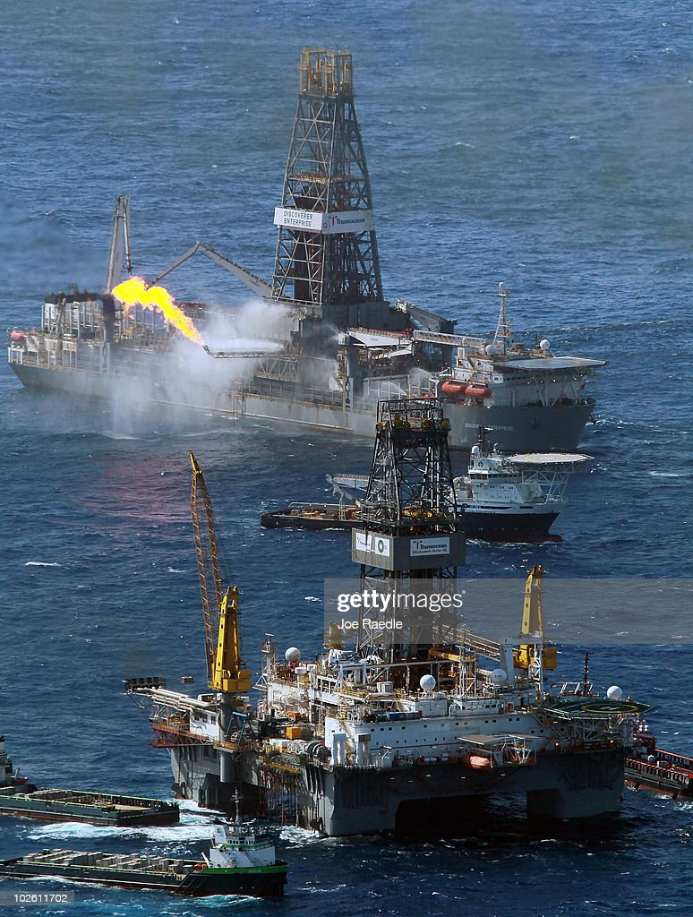 The Transocean Development Driller III (R) and the Discoverer Enterprise drilling rig continue the effort to recover oil and cap the Deepwater Horizon spill site on July 3, 2010 in the Gulf of Mexico off the coast of Louisiana. Millions of gallons of oil have spilled into the Gulf since the April 20 explosion on the drilling platform.