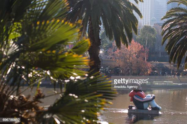 The travelling artwork titled 'Inflatable Refugee' on the Yarra River on June 17 2017 in Melbourne Australia The five metrehigh work depicting a...