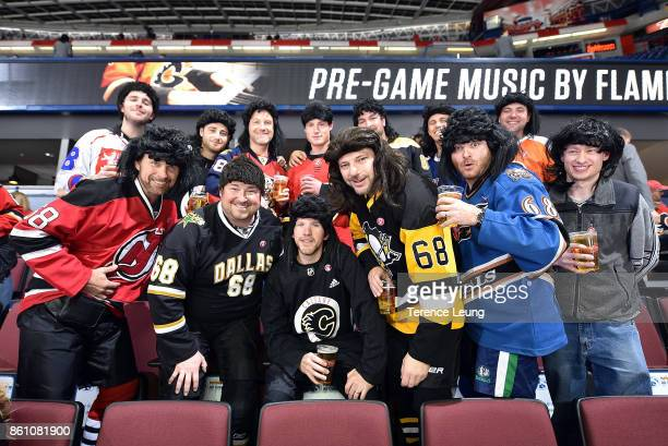 The Travelling Jagr's attend an NHL game between the Calgary Flames and the Ottawa Senators on October 13 2017 at the Scotiabank Saddledome in...