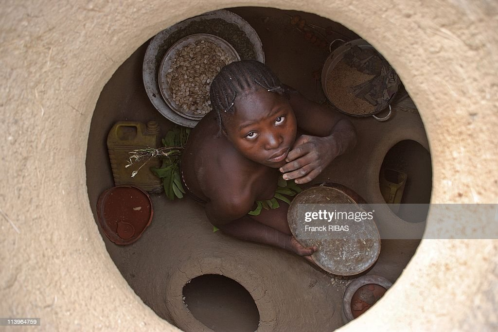 'The tribe of the leaves women', also called Komas In Cameroon In February, 2007-The inside of the graneries is made of several compartments where are stocked the foodstuff.
