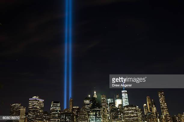 The 'Tribute in Light' illumiinates the skyline of Lower Manhattan as seen from the Brooklyn Heights Promenade September 11 2016 in New York City...