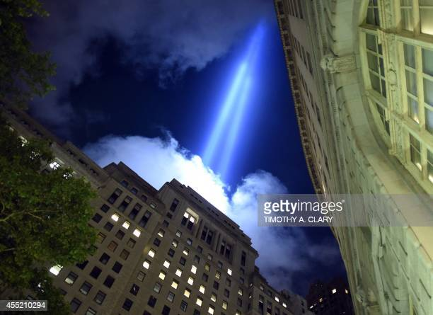 The Tribute in Light illuminates the sky down in the Wall Street area of lower Manhattan in New York on September 10 2014 on the night before the...