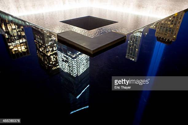 The 'Tribute in Light' is reflected in one of the two pools at the 9/11 Memorial September 11 2014 in New York This year marks the 13th anniversary...